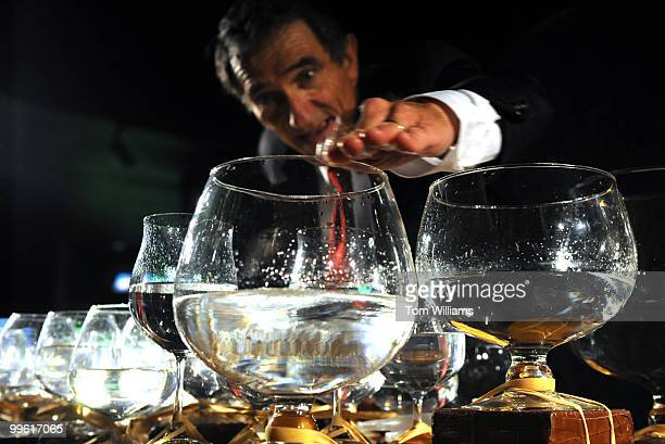 Jamey Turner plays the glass harp during a reception at the National Aquarium which held a reopening reception at it's location in the lower level of...