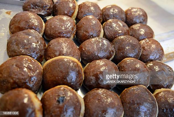 Jamfilled Paczki doughnuts are on sale in a popular sweet shop in Warsaw on Fat Thursday on February 7 2013 AFP PHOTO/JANEK SKARZYNSKI