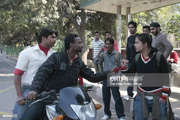 Jamghat Volunteers stage an invisible theatre skit on sexual harassment in Delhi India