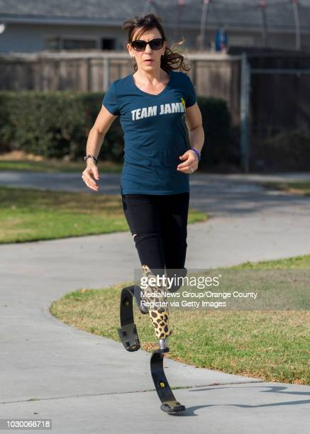 Jami Marseilles, shown in running at a park near her Huntington Beach home on Tuesday, Jan. 2 which is the 30th anniversary of the day her and a...