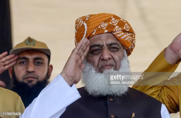 Jamiat Ulemae Islam Fazal chief Maulana FazalurRehman  salutes as he watches the preparations of an 'Azadi' march in Peshawar on October 13 2019 JUIF...