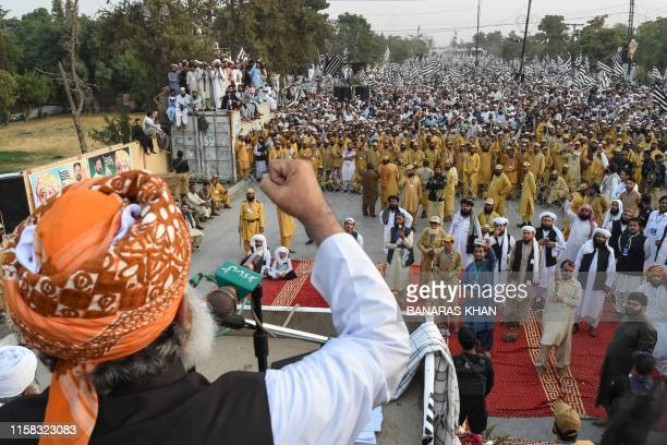 Jamiat UlmaeIslam political party leader Maulana FazalurRehman gestures as he delivers a speech to supporters during antigovernment rally in Quetta...