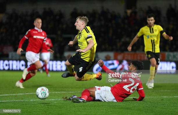 Jamie Allen of Burton Albion is fouled by Liam Bridcutt of Nottingham Forest for a penalty during the Carabao Cup Fourth Round match between Burton...