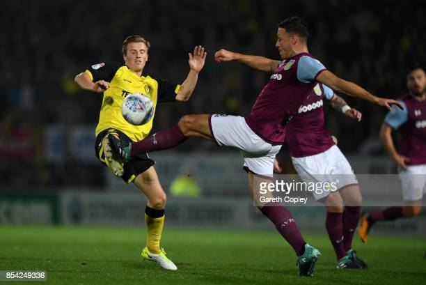 Jamie Allen of Burton is tackled by James Chester of Aston Villa during the Sky Bet Championship match between Burton Albion and Aston Villa at...
