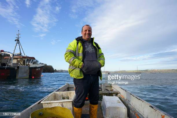 Jamie Altenberg, skipper of The Harvester II fishing trawler, returns from a day's work to Mylor Harbour on March 17, 2021 in Falmouth, Cornwall,...