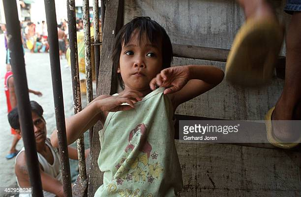 Jamie at a cell barrack at Manila City Jail. Her father Jaime is a member of Batang City Jail, one of the 4 major gangs in Manila. He is accused of...
