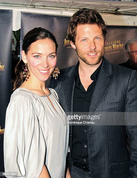Jamie Bamber and his wife attend attend the Jules Verne Adventure Festival Film at the Grand Rex cinema in Parison April 24,2009 Paris, France.