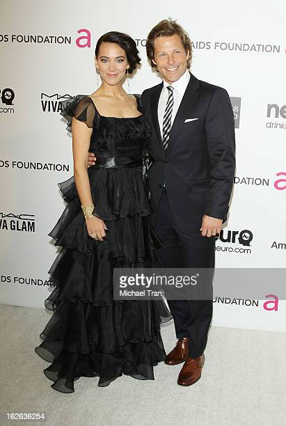 Jamie Bamber and Kerry Norton arrive at the 21st Annual Elton John AIDS Foundation Academy Awards viewing party held at West Hollywood Park on...