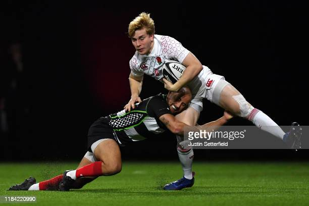 Jamie Barden of England is tackled by Samisoni Viriviri of Barbarians during the Rugby X at The O2 Arena on October 29 2019 in London England