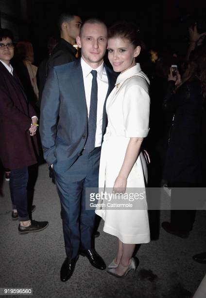 Jamie Bell and Kate Mara wearing Burberry at the Burberry February 2018 show during London Fashion Week at Dimco Buildings on February 17 2018 in...