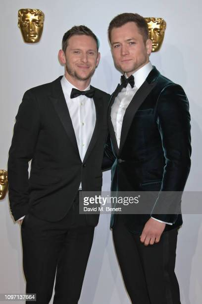 Jamie Bell and Taron Egerton attend the EE British Academy Film Awards at Royal Albert Hall on February 10 2019 in London England