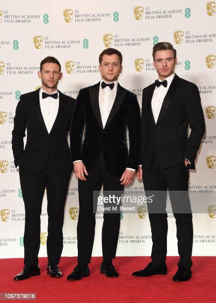 Jamie Bell Taron Egerton and Richard Madden pose in the press room at the EE British Academy Film Awards at Royal Albert Hall on February 10 2019 in...