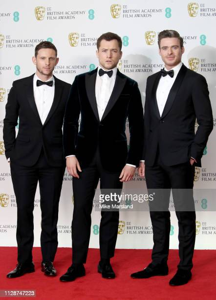 Jamie Bell Taron Egerton and Richard Madden pose in the press room during the EE British Academy Film Awards at Royal Albert Hall on February 10 2019...