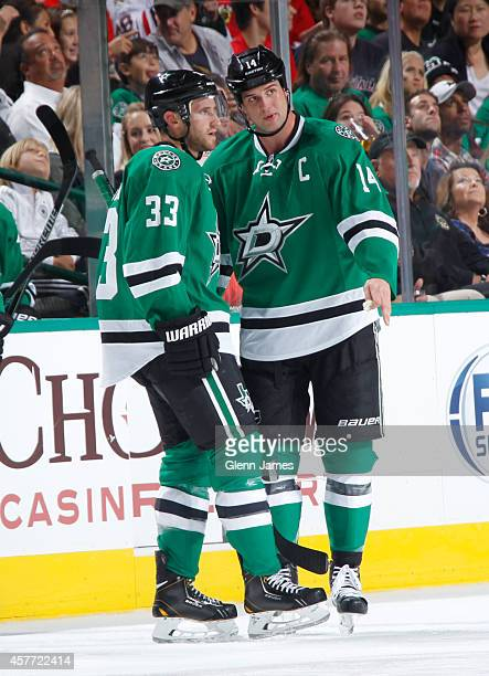 Jamie Benn and Alex Goligoski of the Dallas Stars talk during a stop in the action against the Chicago Blackhawks at the American Airlines Center on...