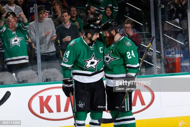 Jamie Benn and Jordie Benn of the Dallas Stars celebrate a goal against the Arizona Coyotes at the American Airlines Center on February 24 2017 in...