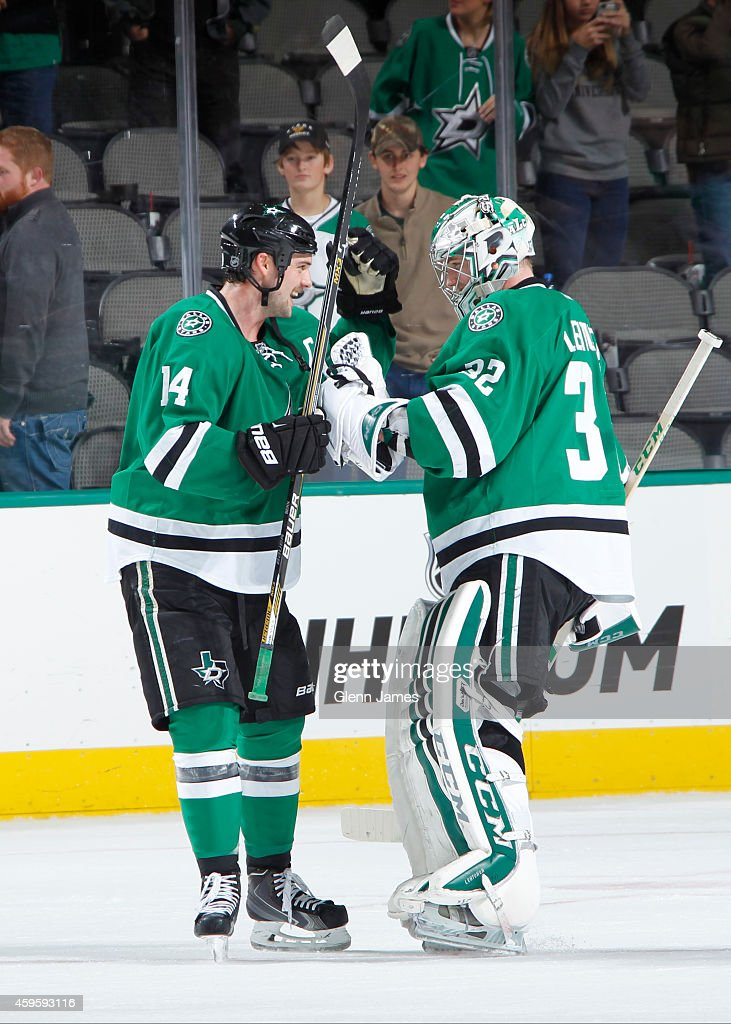 Jamie Benn #14 and Kari Lehtonen #32 of the Dallas Stars celebrate a win against the Edmonton Oilers at the American Airlines Center on November 25, 2014 in Dallas, Texas.