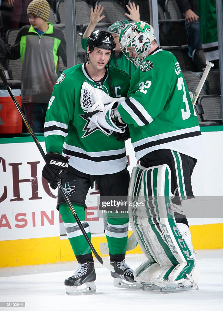 Jamie Benn #14 and Kari Lehtonen #32 of the Dallas Stars celebrate a win against the Florida Panthers at the American Airlines Center on February 13, 2015 in Dallas, Texas.