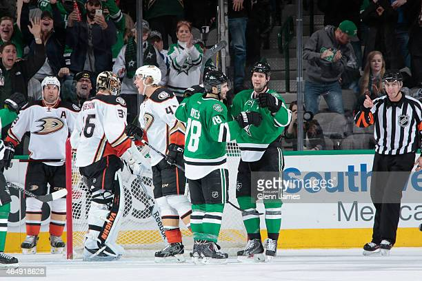 Jamie Benn and Patrick Eaves of the Dallas Stars celebrate a goal against the Anaheim Ducks at the American Airlines Center on March 1 2015 in Dallas...