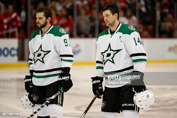 Jamie Benn and Tyler Seguin of the Dallas Stars during the national anthem prior to playing the Detroit Red Wings at Joe Louis Arena on November 29...