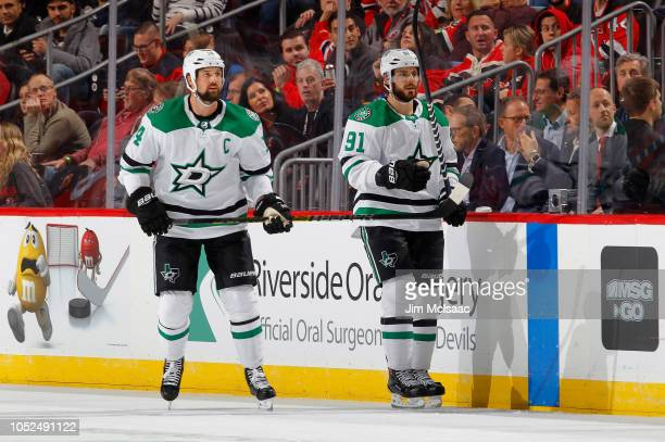 Jamie Benn and Tyler Seguin of the Dallas Stars in action against the New Jersey Devils at Prudential Center on October 16 2018 in Newark New Jersey...