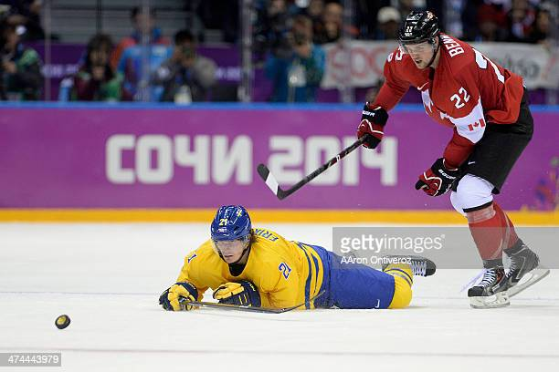 Jamie Benn of Canada pushes Loui Eriksson of Sweden to the ice during the third period of Canada's 30 win in the men's ice hockey gold medal game...