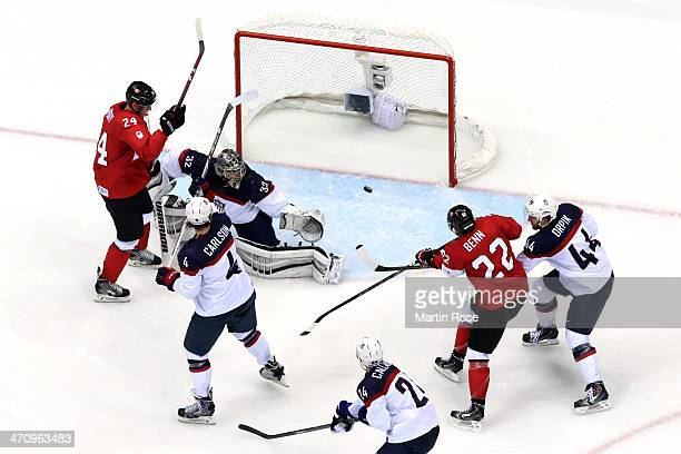 Jamie Benn of Canada scores a secondperiod goal against Jonathan Quick of the United States during the Men's Ice Hockey Semifinal Playoff on Day 14...