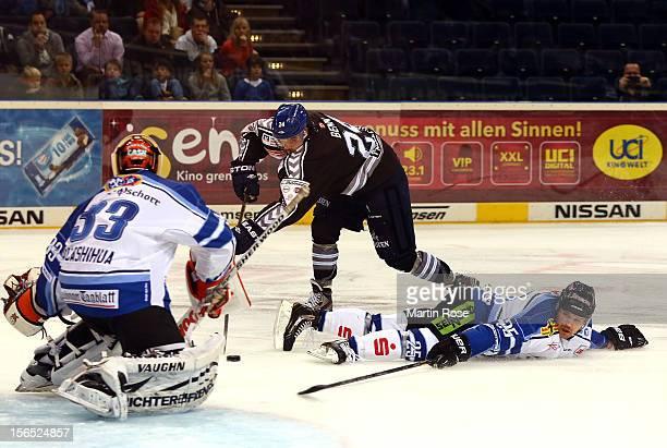 Jamie Benn of Hamburg fails to score over Jason Bacashihua , goaltender of Straubing during the DEL match between Hamburg Freezers and Straubing...