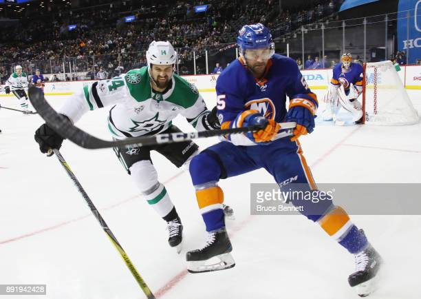 Jamie Benn of the Dallas Stars and Johnny Boychuk of the New York Islanders pursue the puck during the first period at the Barclays Center on...