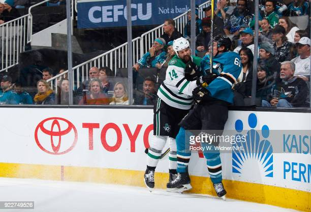 Jamie Benn of the Dallas Stars and Justin Braun of the San Jose Sharks get into an altercation at SAP Center on February 18 2018 in San Jose...