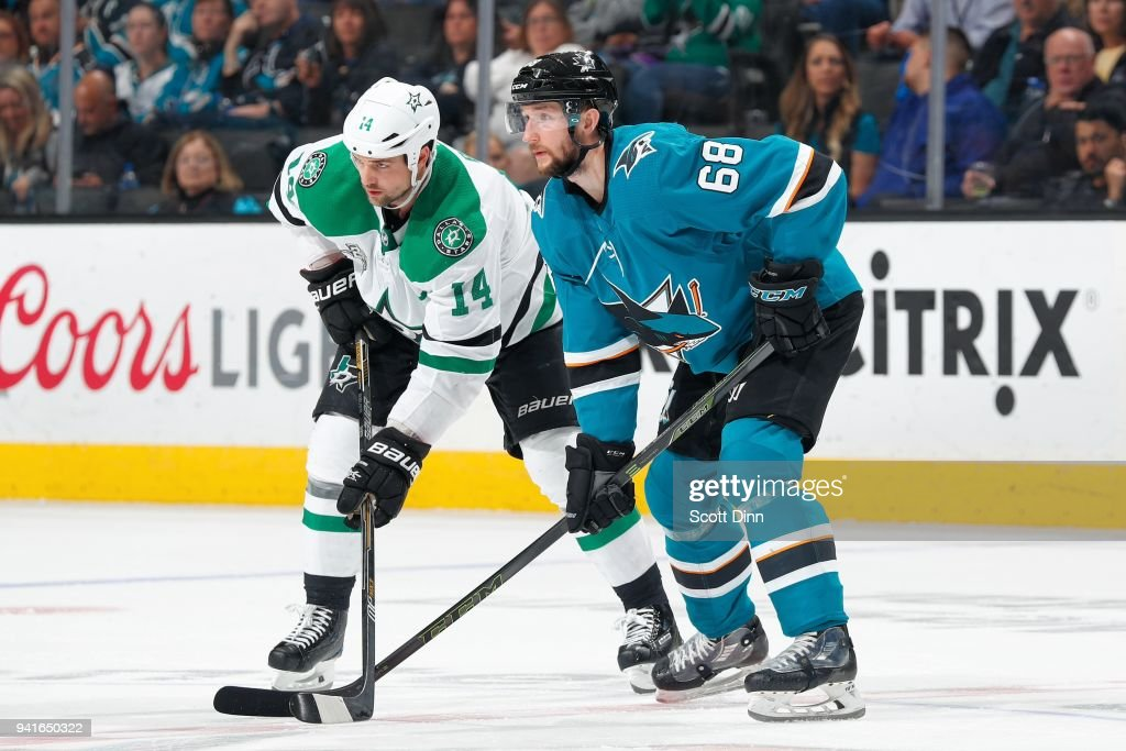 Jamie Benn #14 of the Dallas Stars and Melker Karlsson #68 of the San Jose Sharks get ready at SAP Center on April 3, 2018 in San Jose, California.