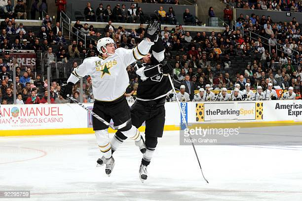 Jamie Benn of the Dallas Stars and Rob Scuderi of the Los Angeles Kings jump for the puck on October 22 2009 at Staples Center in Los Angeles...