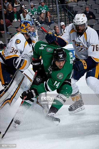 Jamie Benn of the Dallas Stars battles for position in front of the net against Marek Mazanec and PK Subban of the Nashville Predators at the...