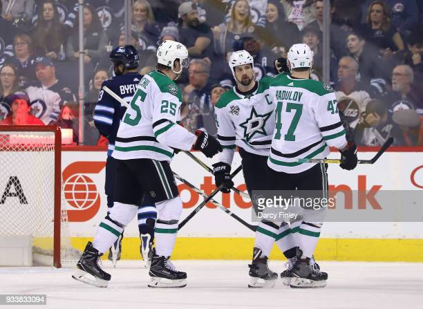 Jamie Benn of the Dallas Stars celebrates his second period against the Winnipeg Jets with teammates Brett Ritchie and Alexander Radulov at the Bell...