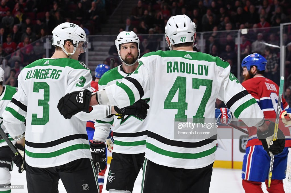 Jamie Benn #14 of the Dallas Stars celebrates with teammates after scoring a goal against the Montreal Canadiens in the NHL game at the Bell Centre on March 13, 2018 in Montreal, Quebec, Canada.