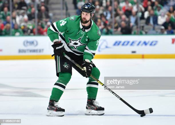 Jamie Benn of the Dallas Stars handles the puck against the Chicago Blackhawks at the American Airlines Center on November 21 2019 in Dallas Texas