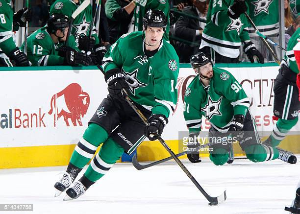 Jamie Benn of the Dallas Stars handles the puck against the Detroit Red Wings at the American Airlines Center on February 29 2016 in Dallas Texas