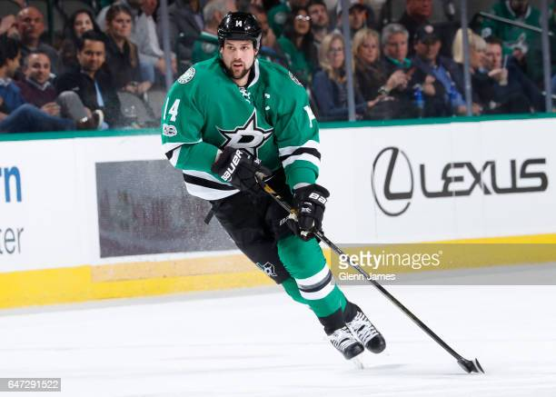 Jamie Benn of the Dallas Stars handles the puck against the New York Islanders at the American Airlines Center on March 3 2017 in Dallas Texas