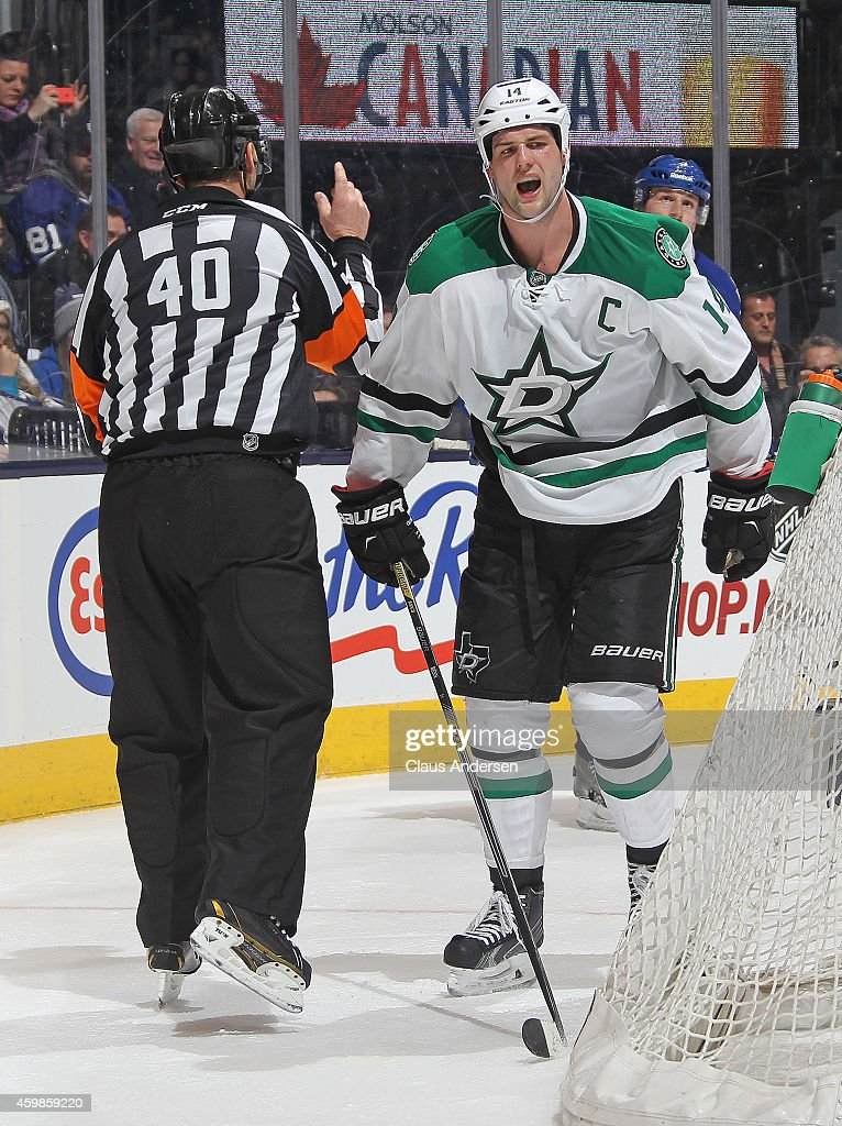 Jamie Benn #14 of the Dallas Stars is called for a high-sticking penalty late against the Toronto Maple Leafs during an NHL game at the Air Canada Centre on December 2, 2014 in Toronto, Ontario, Canada. The Leafs defeated the Stars 5-3.