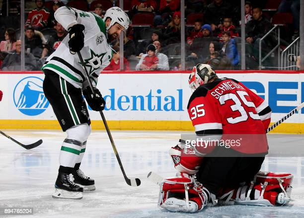 Jamie Benn of the Dallas Stars is unable to get a shot past Cory Schneider of the New Jersey Devils on December 15 2017 at Prudential Center in...