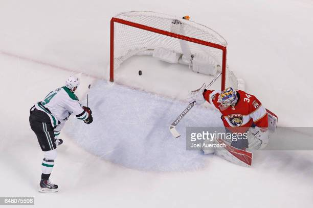 Jamie Benn of the Dallas Stars scores a goal past goaltender James Reimer of the Florida Panthers during first period action at the BBT Center on...