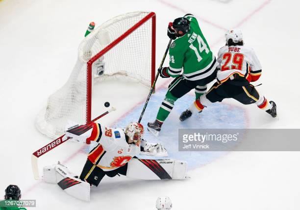 Jamie Benn of the Dallas Stars scores a shorthanded goal at 1013 of the first period against Cam Talbot of the Calgary Flames in Game Five of the...