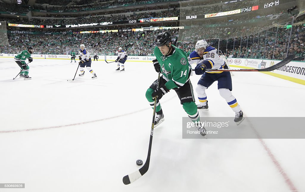 Jamie Benn #14 of the Dallas Stars skates the puck against Paul Stastny #26 of the St. Louis Blues in the third period in Game Seven of the Western Conference Second Round during the 2016 NHL Stanley Cup Playoffs at American Airlines Center on May 11, 2016 in Dallas, Texas.