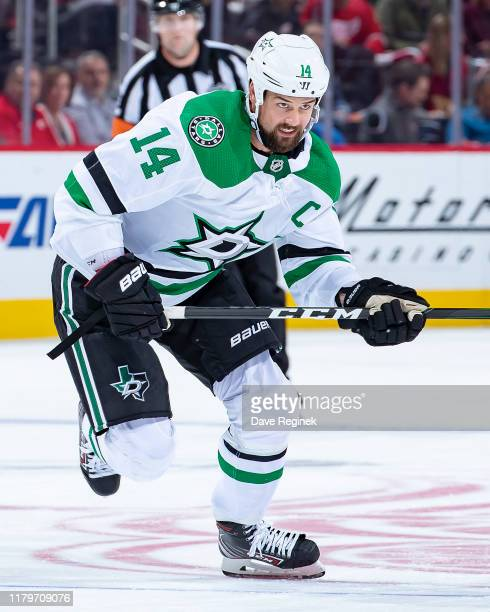 Jamie Benn of the Dallas Stars skates up ice against the Detroit Red Wings during an NHL home opening night game at Little Caesars Arena on October 6...