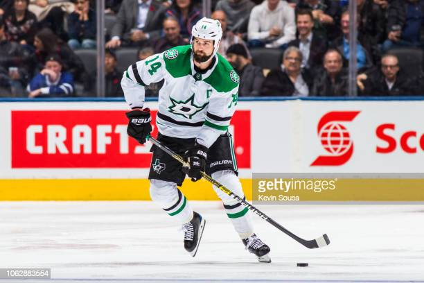 Jamie Benn of the Dallas Stars skates with the puck against the Toronto Maple Leafs during the third period at the Scotiabank Arena on November 1...