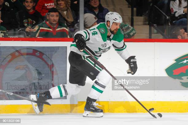 Jamie Benn of the Dallas Stars skates with the puck against the Minnesota Wild during the game at the Xcel Energy Center on December 27 2017 in St...