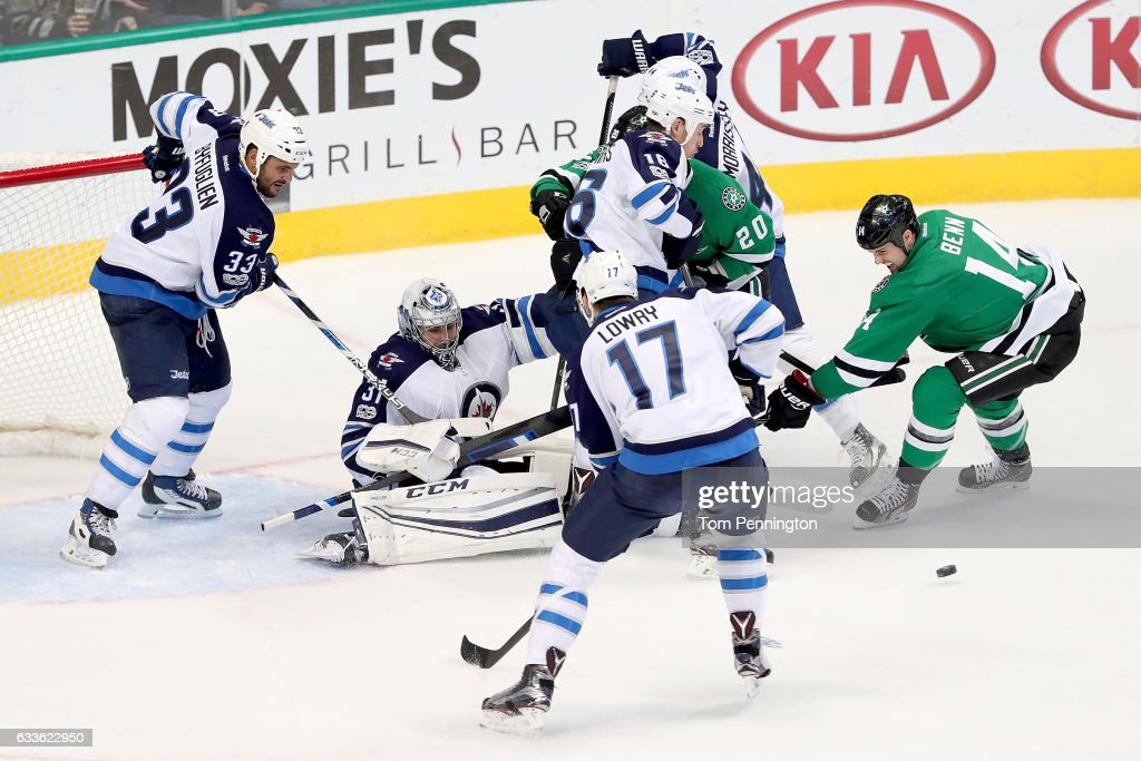 Jamie Benn #14 of the Dallas Stars takes a shot on goal against Ondrej Pavelec #31 of the Winnipeg Jets in the third period at American Airlines Center on February 2, 2017 in Dallas, Texas.
