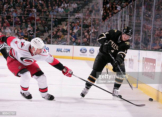 Jamie Benn of the Dallas Stars tries to keep the puck away against Aaron Ward of the Carolina Hurricanes on November 23 2009 at the American Airlines...