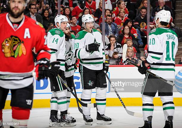 Jamie Benn Patrick Eaves and Jason Spezza of the Dallas Stars celebrate after the Stars scored their third goal in the first period of the NHL game...