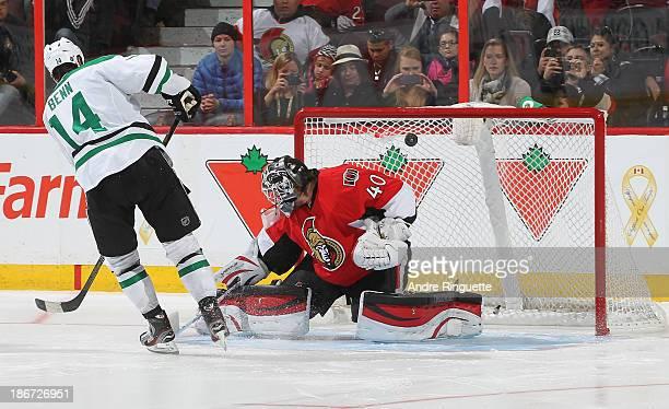 Jamie Benn the Dallas Stars scores the shootout winner against Robin Lehner of the Ottawa Senators at Canadian Tire Centre on November 3 2013 in...