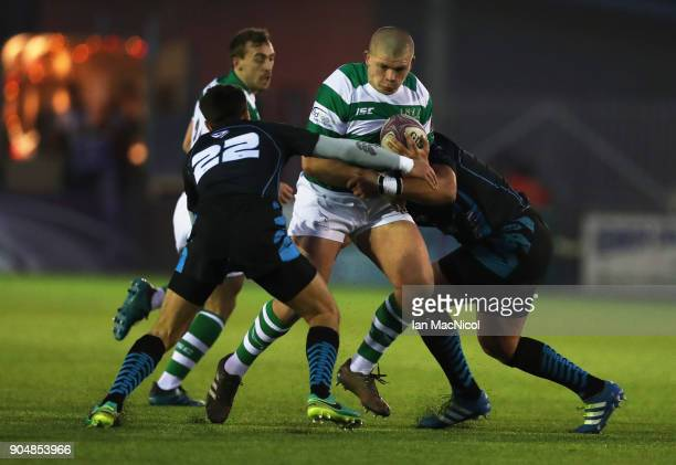Jamie Blamire of Newcastle Falcons is tackled by Evgeny Nepeivoda of EniseiSTM during the European Rugby Challenge Cup match between Newcastle...